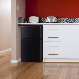 Arctic King 3.2 cubic feet, 2 door mini fridge and freezer black in place.